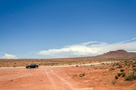 Lonely car in the red sand desert