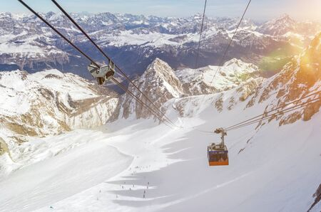 Gondola of cable car in beautiful mountain landscape above a ski resort in winter