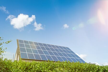 House with solar panels on the roof on a bright sunny day with scenic lens flare