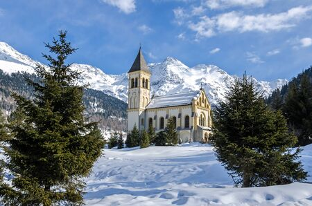 Romantic historic chapel in beautiful mountain landscape in winter