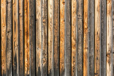 Background, rustic, weathered brown orange and black wooden wall