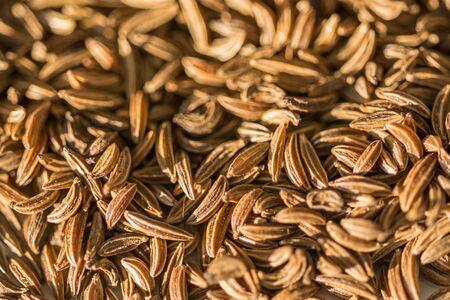 Closeup macro shot of brown caraway seeds