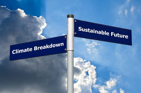 Crossroads sign symbolizing choice between climate breakdown and a sustainable future