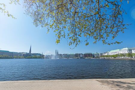 Panoramic view of the Alster river (Binnenalster) and historic buildings in the city centre of Hamburg, Germany Фото со стока