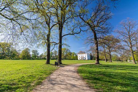 Foot path in a beautiful landscaped park (Jenischpark) in Hamburg, Germany