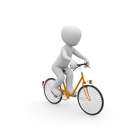 A character runs comfortably on an orange bike along the road. photo