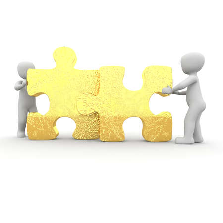 The two characters move two large puzzle pieces together. Stock Photo - 20497652