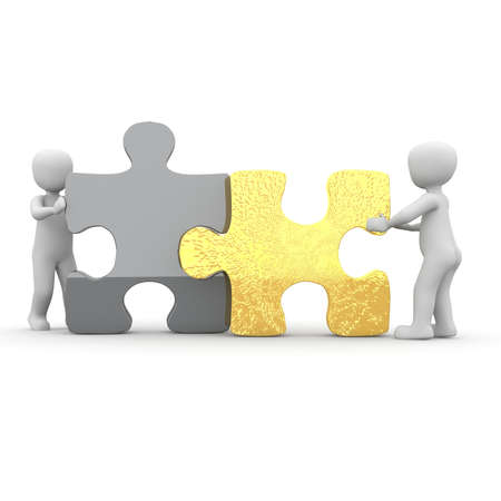 enterprising: The two characters move two large puzzle pieces together. Stock Photo