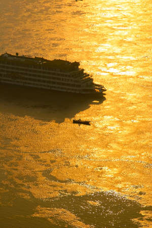 german north sea region: ship heading towards sunset on a River in China Stock Photo