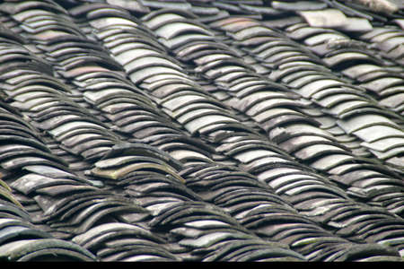 tradional: In Lijiang buildings are built in a tradional old style. The rooftops are made of curved stone tiles. Stock Photo