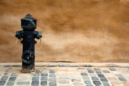 muster: texture of the wall with red hydrant Stock Photo