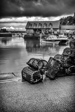 lobster pots: Lobster pots on quayside at Mevagissey Editorial
