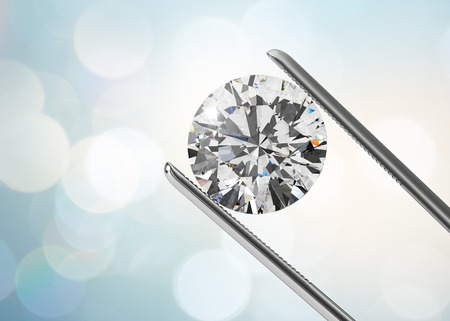 Luxury diamond in tweezers closeup with bright bokeh background