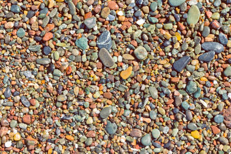Abstract Colorful Pebbles Background. Beautiful Colorful Pebbles Texture. Colorful Sea Stone Background. Abstract Nature Background Stockfoto