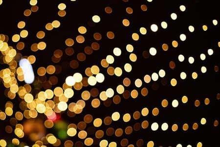 Christmas golden bokeh lights background. Defocused Christmas tree decoration backdrop