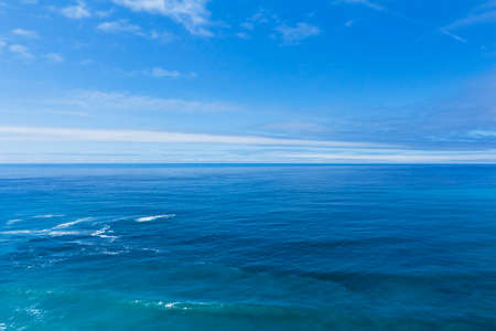 Blue Ocean Waves Background With Few Clouds in The Sky. California Coast. Blue Sky Color