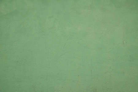 Old Green Grunge Plaster Texture Wall Background. Green wall background