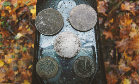 Searching with metal detector. Coins in hand