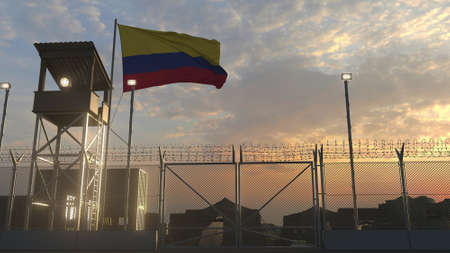 National flag of Colombia above military base at sunset