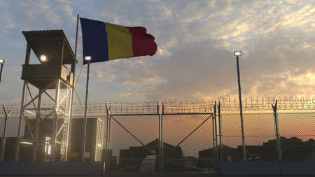 Waving flag of Romania above military base in the evening