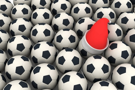 soccer balls and santa claus red hat photo