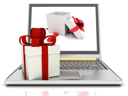 teclado numerico: Portátil y regalos en el fondo blanco Foto de archivo