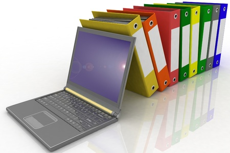 Colorful folders next to a modern laptop Stock Photo - 11895869