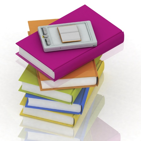 pocket pc and stacks of books on white background photo