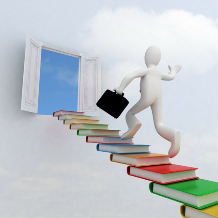 Businessman climbing the stairs to the success of knowledge photo