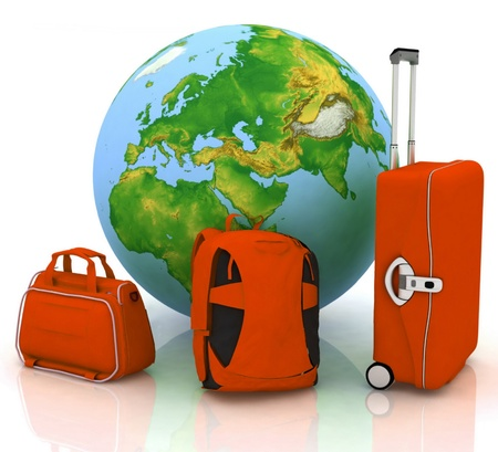 bags for travel on the background of the globe photo