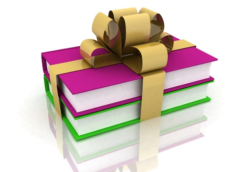 books with a bow on white background photo