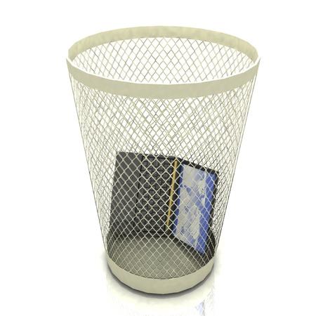 disposed: broken laptop in basket for garbage on white background