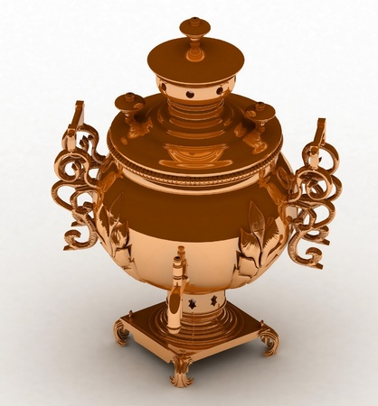 Old golden samovar isolated on a white background photo