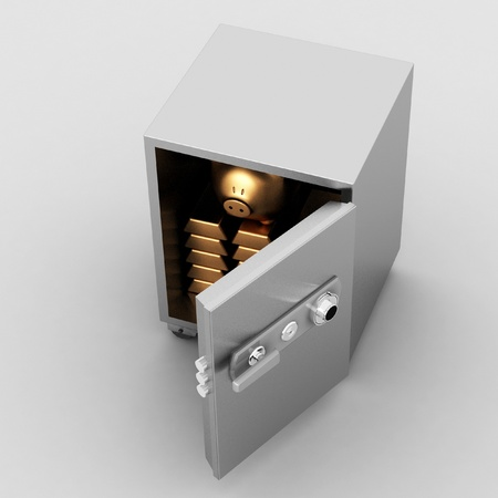 bullions and piggy bank in a security safe photo