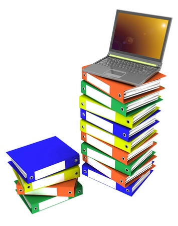 Colorful folders next to a modern laptop Stock Photo - 12050781
