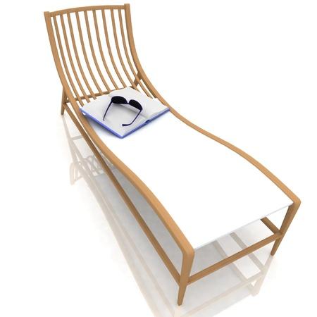 livre et des lunettes se trouvant sur une chaise longue
