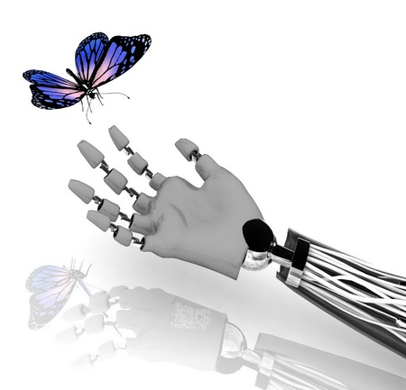 The butterfly on a hand of the robot Stock Photo - 12050648