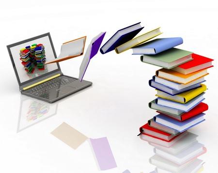 libros abiertos: los libros de volar en su computadora port�til Foto de archivo