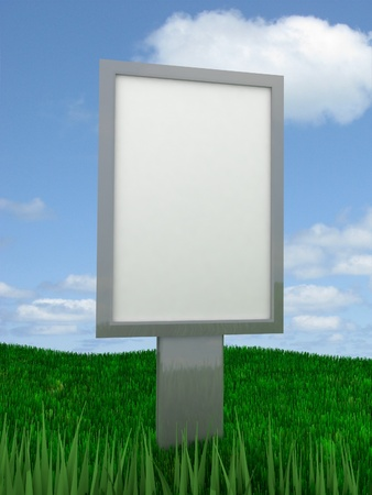 billboard stands in the middle of grass against the sky photo