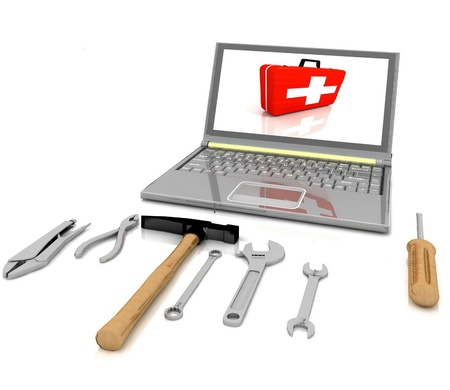 The laptop with the complete set of tools for repair photo