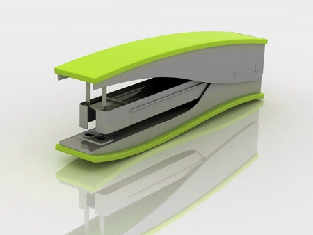 Stapler with reflection on white background photo