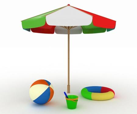 kind speelgoed voor een strand onder een paraplu Stockfoto