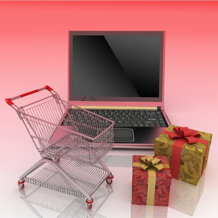 Shopping-cart and laptop. Conception of purchase of gifts on the internet photo