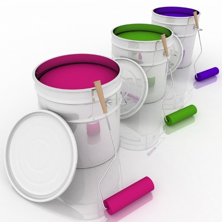 open bucket with color paint and rollers photo