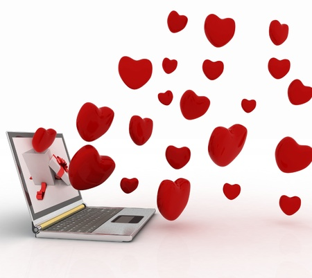hearts take off from the screen of laptop photo