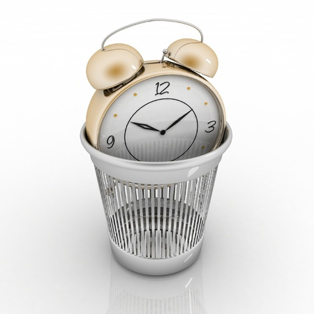 alarm clock in metal trash bin isolated on white  Concept of vain pastime  免版税图像