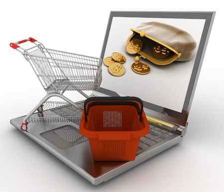 Shopping cart and basket on laptop. The concept of purchase of consumer goods on the Internet Stock Photo - 18238540
