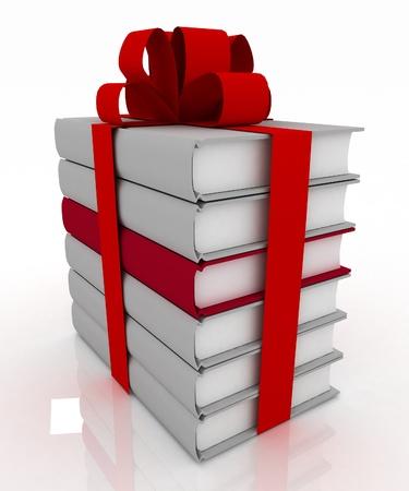 lazo regalo: libros con un arco sobre fondo blanco Foto de archivo
