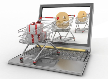 Shopping carts and laptop  The concept of buying gifts and commodities on the Internet photo