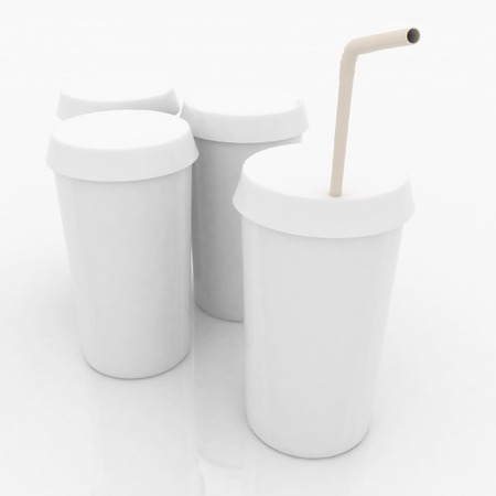 white plastic fast food glasses with tubule on a white  photo